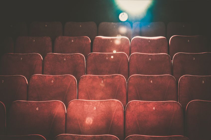 36044092 - empty comfortable red seats with numbers in cinema