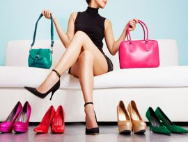 52756088 - colorful shoes and bags with woman sitting on the sofa.